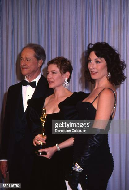 Actors Don Ameche Dianne Wiest and Anjelica Huston attends the Academy Awards in March 1987 in Los Angeles California