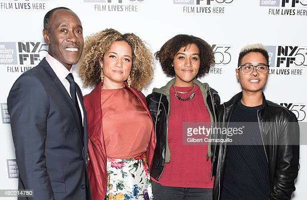 Actors Don Cheadle Bridgid Coulter pose with their daughters Imani Cheadle and Ayana Tai Cheadle during 53rd New York Film Festival closing night...