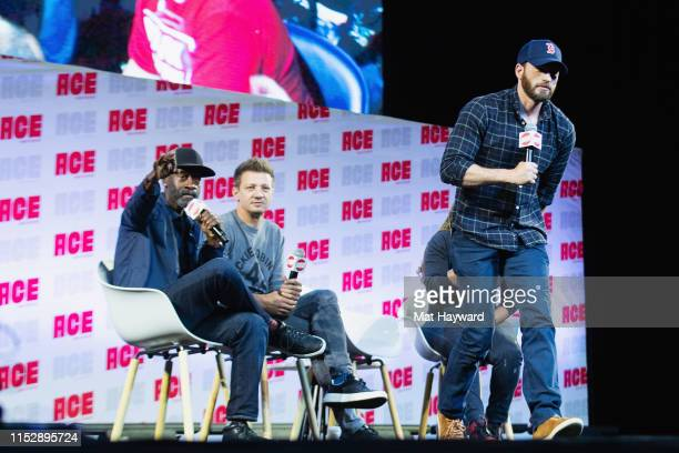 Actors Don Cheadle, Jeremy Renner and Chris Evans speak on stage during ACE Comic Con at Century Link Field Event Center on June 28, 2019 in Seattle,...