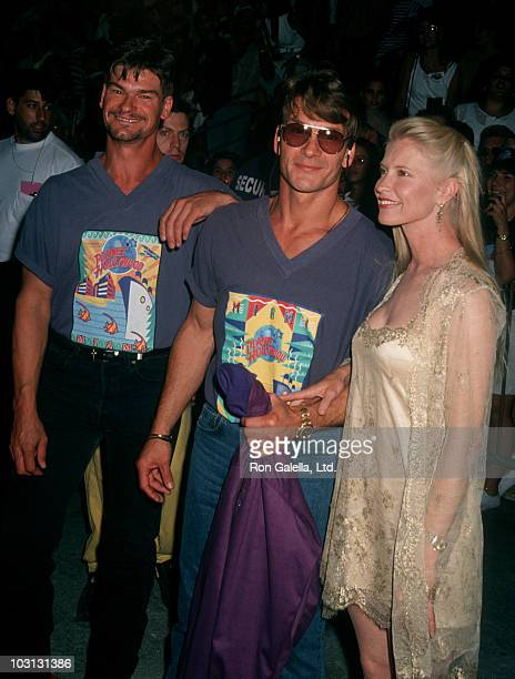 Actors Don Swayze and Patrick Swayze and wife Lisa Niami attend the grand opening of Planet Hollywood on May 15 1994 in Miami Florida