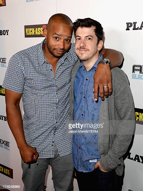 Actors Donald Faison and Christopher MintzPlasse arrive at the Playboy and Universal Pictures' 'KickAss 2' event at ComicCon sponsored by AXE Black...