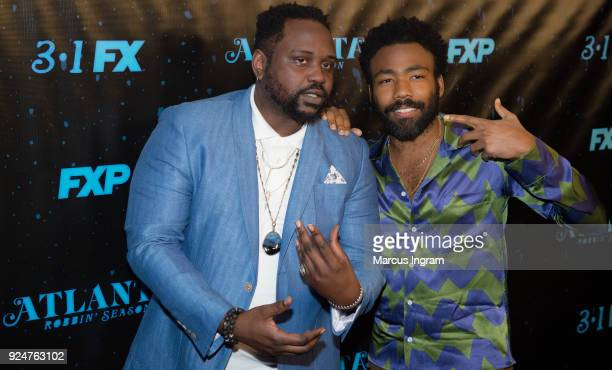 """Actors Donald Glover and Brian Tyree Henry attend the """"Atlanta Robbin' Season"""" Atlanta premiere at Starlight Six Drive on February 26, 2018 in..."""