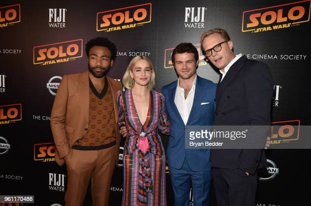 Actors Donald Glover Emilia Clarke Alden Ehrenreich and Paul Bettany attends FIJI Water with the Cinema Society host a screening of 'Solo A Star Wars...