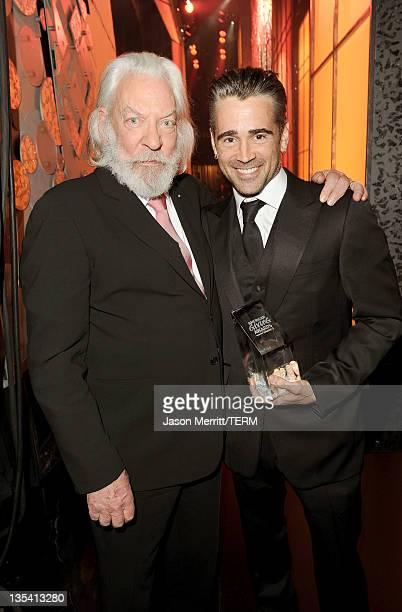Actors Donald Sutherland and Colin Farrell pose backstage at the American Giving Awards presented by Chase held at the Dorothy Chandler Pavilion on...