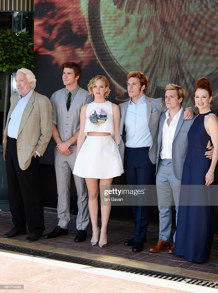 Actors Donald Sutherland, Liam Hemsworth, Jennifer Lawrence, Sam Claflin, Josh Hutcherson and Julianne Moore attend 'The Hunger Games: Mockingjay Part 1' photocall at the 67th Annual Cannes Film Festival on May 17, 2014 in Cannes, France.