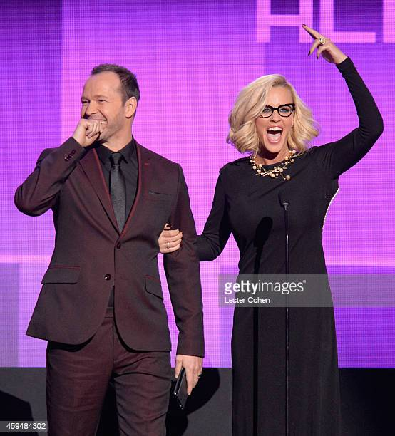 Actors Donnie Wahlberg and Jenny McCarthy speak onstage at the 2014 American Music Awards at Nokia Theatre LA Live on November 23 2014 in Los Angeles...
