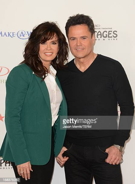 Actors Donny Osmond and Marie Osmond attend the 4th Annual National Believe Day at Macy's Pasadena on December 14 2012 in Pasadena California