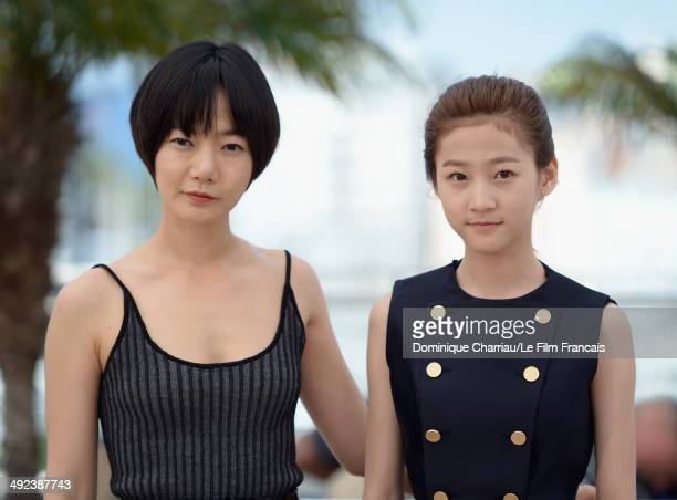 Actors Doona Bae and Kim Sae Ron attend the 'A Girl At My Door' photocall at the 67th Annual Cannes Film Festival on May 20 2014 in Cannes France