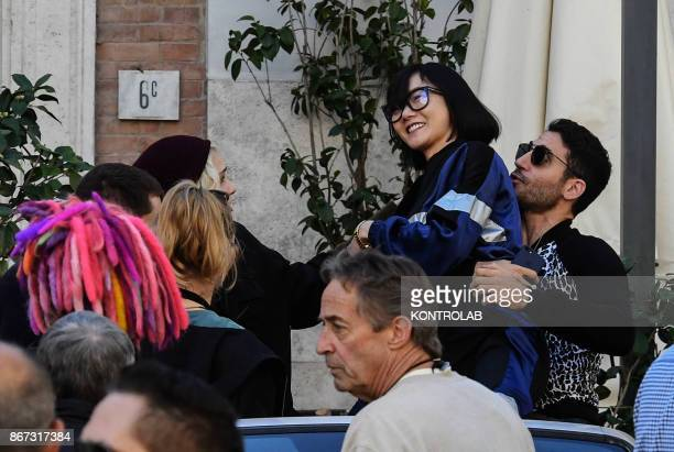 Actors Doona Bae and Miguel Angel Silvestre joke on the set of Netflix TV scifi series 'Sense8' in the Station in Naples