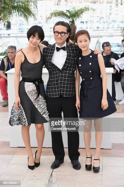 Actors Doona Bae Song Sae Byuk and Kim Sae Ron attend the 'A Girl At My Door' photocall at the 67th Annual Cannes Film Festival on May 20 2014 in...