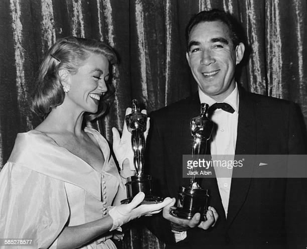 Actors Dorothy Malone and Anthony Quinn holding their Oscars at the 29th Academy Awards March 27th 1957