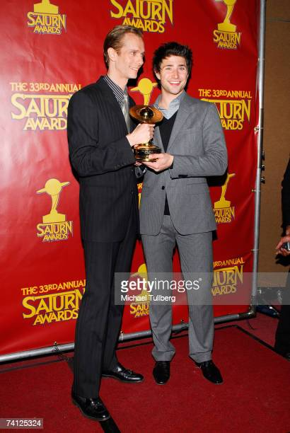 Actors Doug Jones and Matt Dallas pose with a Saturn Award following the 33rd Annual Saturn Awards for science fiction in mass media held at the...