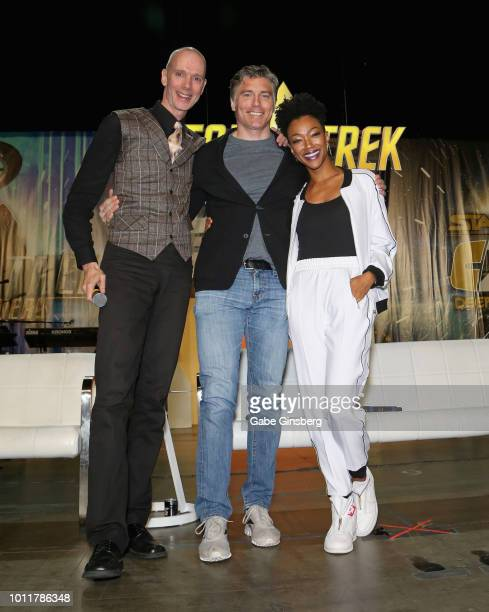 Actors Doug Jones Anson Mount and actress Sonequa MartinGreen pose at the Discovery Part 5 panel during the 17th annual official Star Trek convention...