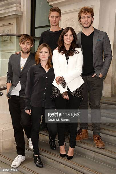 Actors Douglas Booth Holliday Grainger Max Irons Jessica Brown Findlay and Sam Claflin pose at a photocall for The Riot Club at the Corinthia Hotel...