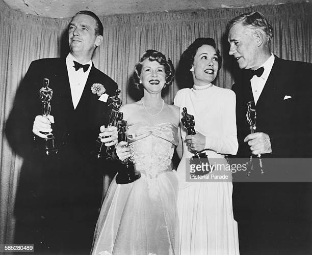 Actors Douglas Fairbanks Jnr Claire Trevor Jane Wyman and Walter Huston holding their Oscars at the 21st Academy Awards Los Angeles March 24th 1949