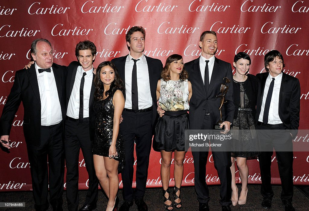 Actors Douglas Urbanski, Andrew Garfield, Brenda Song, Armie Hammer, Rashida Jones, Josh Pence, Rooney Mara, and Jesse Eisenberg pose backstage with the Ensemble Performance Award at the 22nd Annual Palm Springs International Film Festival Awards Gala at the Palm Springs Convention Center on January 8, 2011 in Palm Springs, California.