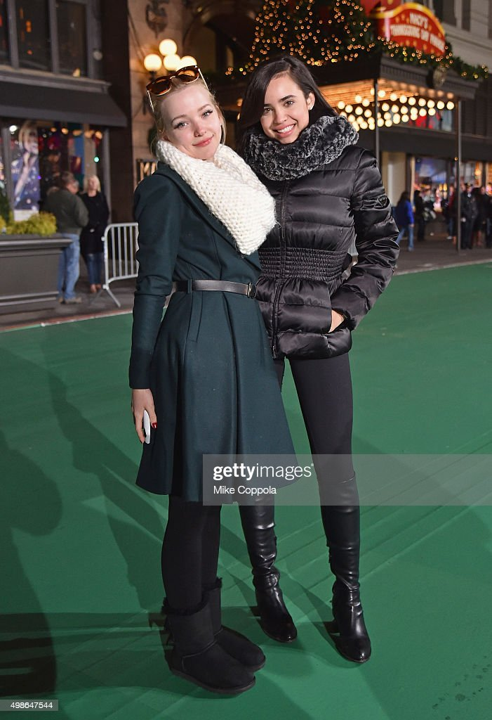 Actors Dove Cameron (L) and Sofia Carson pose for a picture at the 89th Annual Macy's Thanksgiving Day Parade Rehearsals - Day 2 on November 24, 2015 in New York City.
