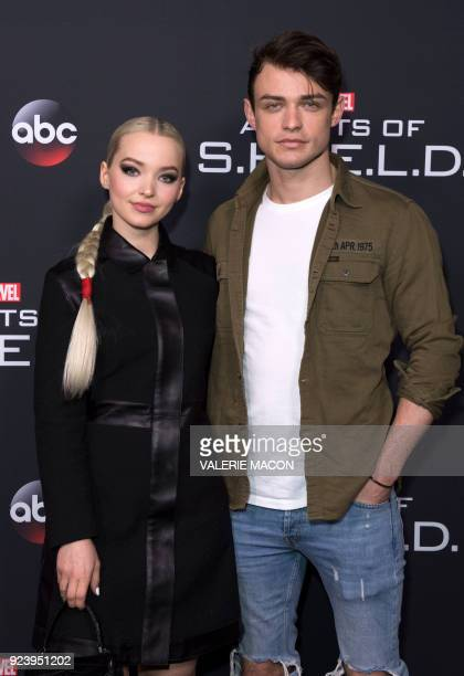 Actors Dove Cameron and Thomas Doherty attend Marvels Agents of SHIELD 100th Episode Celebration in Hollywood California on February 24 2018 / AFP...