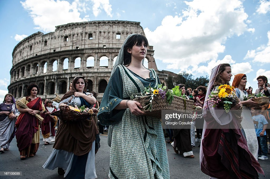 Actors dressed as ancient Roman maids march in front of the Coliseum in a commemorative parade during festivities marking the 2,766th anniversary of the founding of Rome on April 21, 2013 in Rome, Italy. The capital celebrates its founding annually based on the legendary foundation of the Birth of Rome. Actors dressed as the denizens of ancient Rome participate in parades and re-enactments of the ancient Roman Empire. According to legend, Rome had been founded by Romulus in 753 BC in an area surrounded by seven hills.