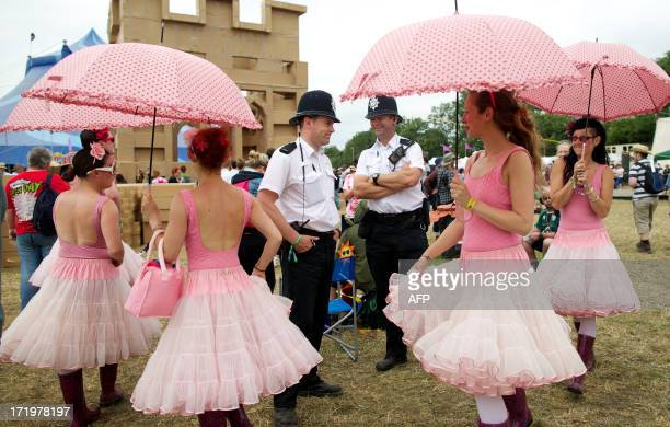 Actors dressed as ballerinas surround policemen in the Circus field on the fifth day of the Glastonbury Festival of Contemporary Performing Arts near...