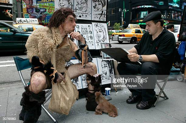 Actors dressed as cavemen roam the city and interact with New Yorkers to promote the new Walking With Cavemen program on Discovery Channel in Times...