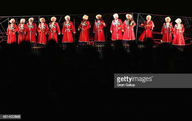 Actors dressed as Cossacks and singing in Russian perform on the Latin Bridge during a theatrical piece commemorating World War I near the spot where...