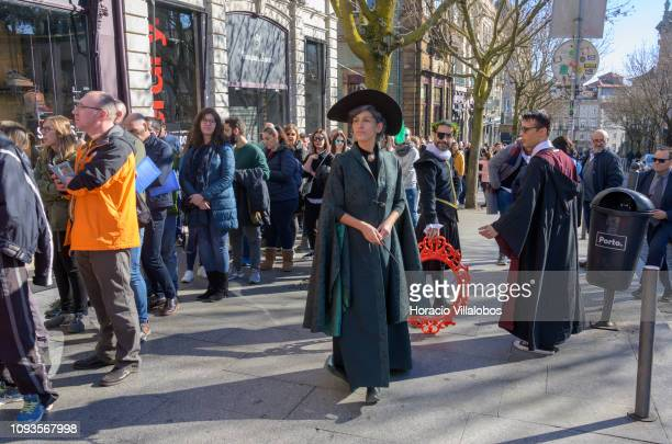 Actors dressed as Harry Potter characters entertain visitors queuing to enter Lello Bookstore to attend events celebrating its 113th anniversary on...