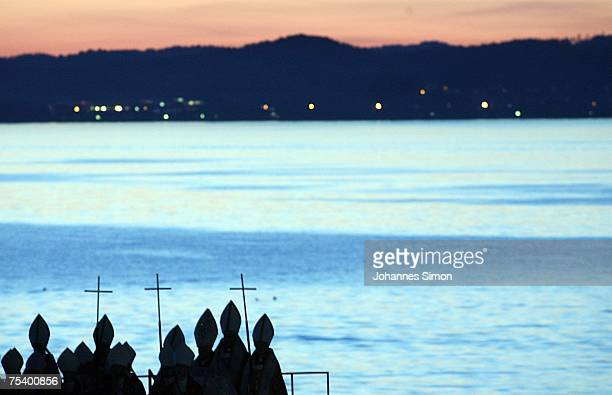Actors dressed as katholic bishops perform on a floating stage during the rehearsal of the opera Tosca by Giacomo Puccini on July 13 2007 in Bregenz...