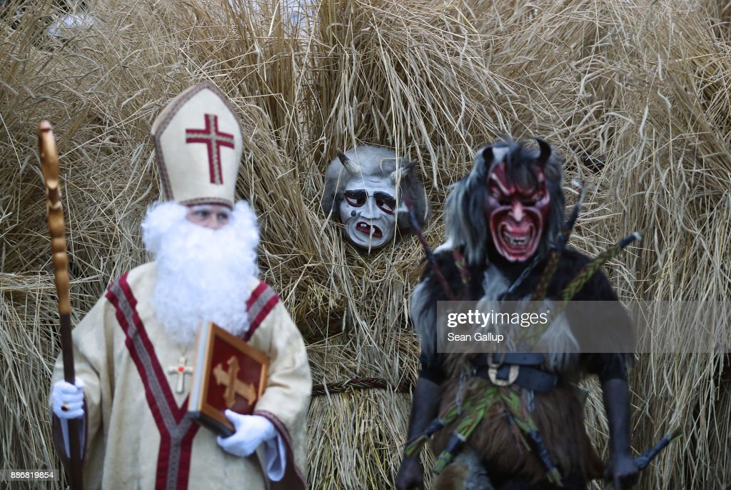 Actors dressed as Saint Nicholas and a Krampus creature lead men dressed in masks and straw in the form of a figure known locally as 'Buttnmandl', or 'Shaking Man', as walk through the town in an annual tradition on December 5, 2017 in Berchtesgaden, Germany. Buttnmandl wears heavy cowbells that he rings by shaking his hips. His role is to drive away the evils spirits of winter and awaken slumbering Mother Nature. He also accompanies Saint Nicholas and goes house to house, visiting families as Saint Nicholas hears which children have been good and which have been bad. Buttnmandl is specific to the Berchtesgadener Land region of southeastern Bavaria but is similar in intent to the more common Krampus, the fur-clad figure with a terrifying mask that has, especially in recent decades, become an intrinsic part of local folklore throughout late November and most of December in the alpine regions of Germany, Austria and Italy.