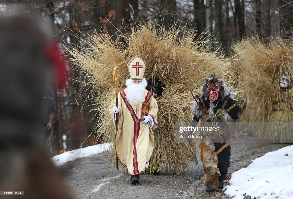 Actors dressed as Saint Nicholas and Krampus creatures lead men dressed in masks and straw in the form of a figure known locally as 'Buttnmandl', or 'Shaking Man', as they ascend toward a meadow above the town in an annual tradition on December 5, 2017 in Berchtesgaden, Germany. Buttnmandl wears heavy cowbells that he rings by shaking his hips. His role is to drive away the evils spirits of winter and awaken slumbering Mother Nature. He also accompanies Saint Nicholas and goes house to house, visiting families as Saint Nicholas hears which children have been good and which have been bad. Buttnmandl is specific to the Berchtesgadener Land region of southeastern Bavaria but is similar in intent to the more common Krampus, the fur-clad figure with a terrifying mask that has, especially in recent decades, become an intrinsic part of local folklore throughout late November and most of December in the alpine regions of Germany, Austria and Italy.