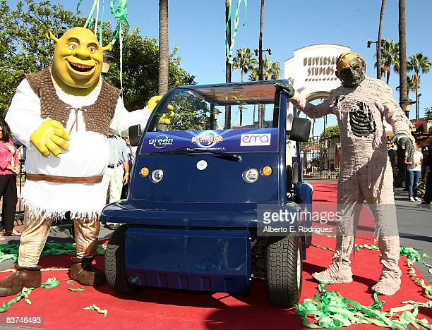 Actors dressed as Shrek and The Mummy attend the introduction of the new solarpowered golf cart at Universal Studios Hollywood November 18 2008 in...
