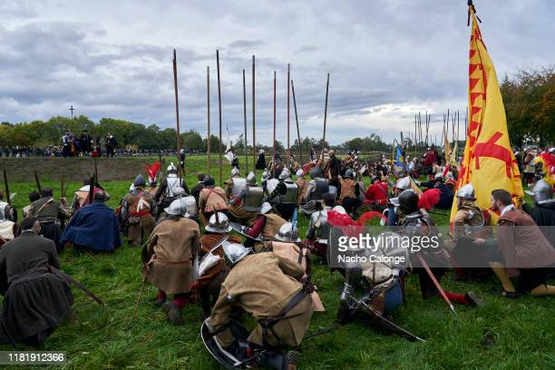Actors dressed as Spanish army soldiers pray before the battle begins on October 18 2019 in Groenlo Netherlands For three days the streets of the...