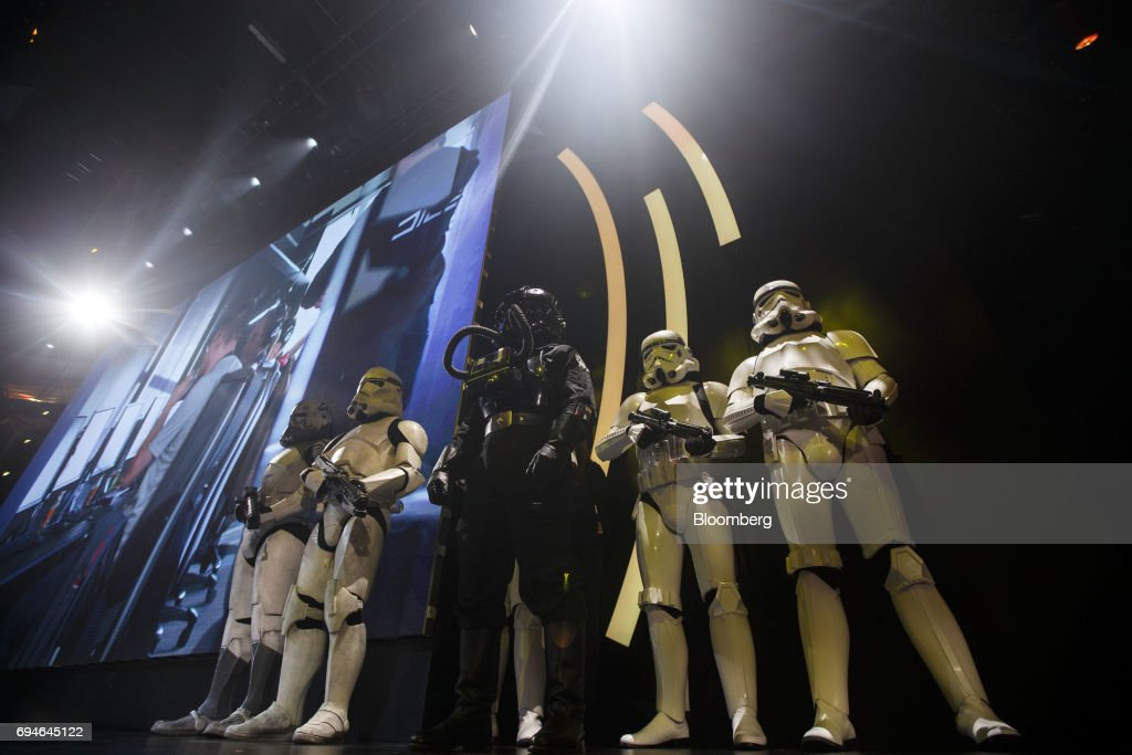 Actors dressed as Stormtroopers, character from the 'Star Wars' film franchise, stand on stage during the Electronic Arts Inc. (EA) Play event ahead of the E3 Electronic Entertainment Expo in Los Angeles, California, U.S., on Saturday, June 10, 2017. EA revealed two new titles along with the annual iterations of the company's sports games, as well as unveiling the highly anticipated 'Star Wars: Battlefront II' open-world multiplayer gameplay. Photographer: Patrick T. Fallon/Bloomberg via Getty Images