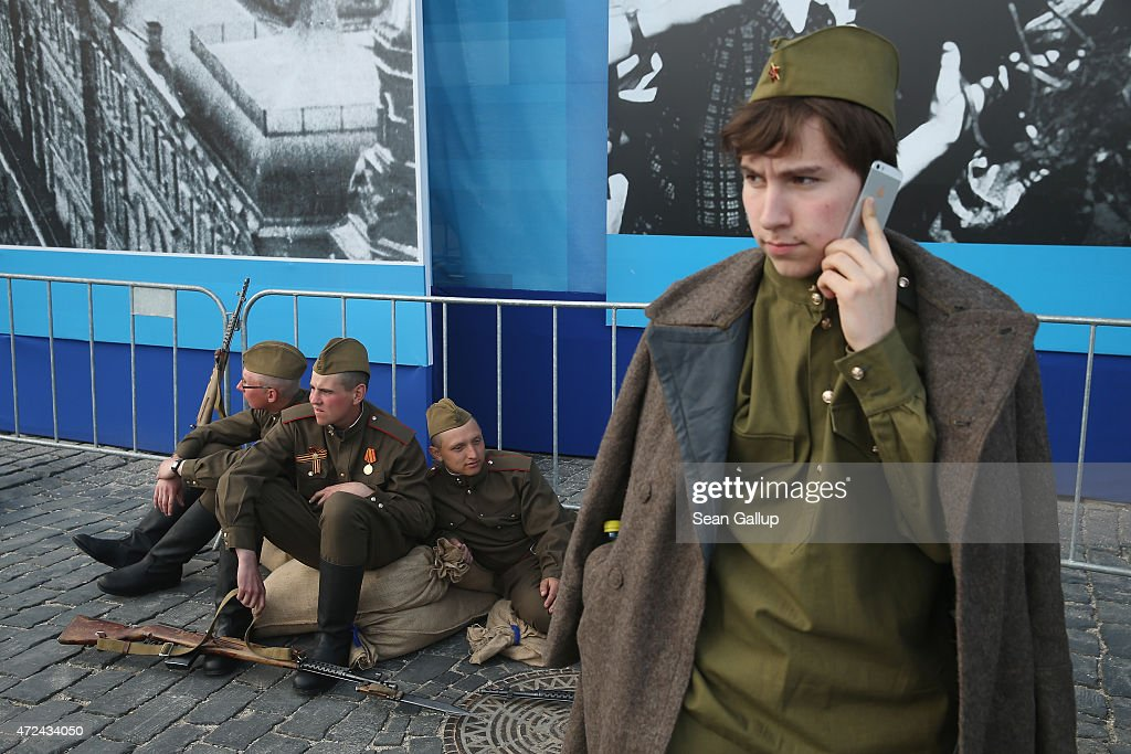 Actors dressed as World War II Soviet Red Army soldiers take a break during rehearsals at Red Square ahead of celebrations to mark the 70th anniversary of the victory over Nazi Germany and the end of World War II on May 7, 2015 in Moscow, Russia. The city of Moscow will celebrate the anniversary on May 9 with a Victory Day international military parade and other events that most European leaders are snubbing because they accuse Russia of involvement in the war in eastern Ukraine.