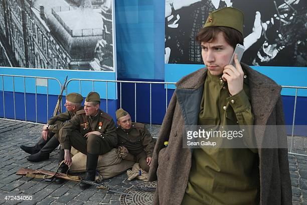 Actors dressed as World War II Soviet Red Army soldiers take a break during rehearsals at Red Square ahead of celebrations to mark the 70th...