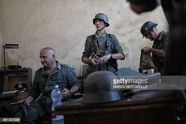 Actors dressed as WWII soldiers take part in a battle reenactment of the raid of Rossana a small village near Cuneo on July 19 2015 This year marks...