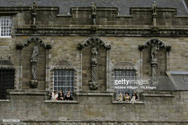 Actors dressed in 16th century costume admire the view from the Royal Lodgings at Stirling Castle at the launch a 12 million project to revamp the...