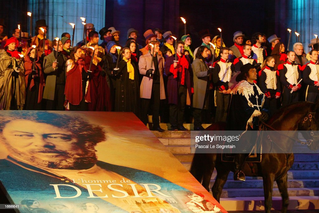 Actors dressed in period costume hold candles during a ceremony to transfer the ashes of author Alexandre Dumas to the Pantheon November 30, 2002 in Paris, France. The Pantheon is the traditional resting place of the remains of France's greatest historical and cultural figures.