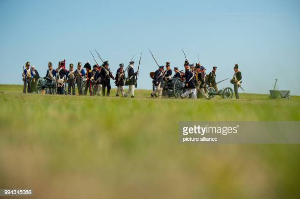 Actors dressed like soldiers carry weapons while walkong across the battlefield near Lueben Germany 17 September 2017 The Battle of the Goehrde...