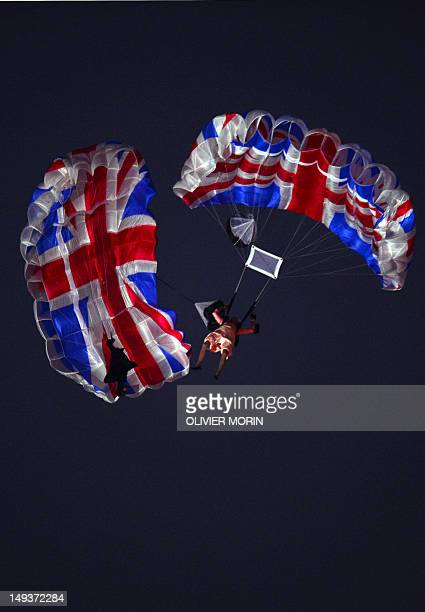 Actors dressed to resemble Britain's Queen Elizabeth II and James Bond parachute into the stadium during the opening ceremony of the London 2012...