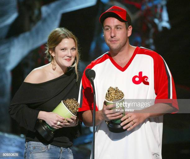 Actors Drew Barrymore and Adam Sandler accept the award for Best OnScreen Team at the 2004 MTV Movie Awards at the Sony Pictures Studios on June 5...