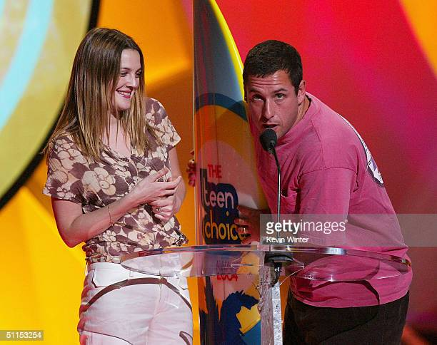 Actors Drew Barrymore and Adam Sandler accept the award for Choice Date Movie on stage at The 2004 Teen Choice Awards held on August 8 2004 at...