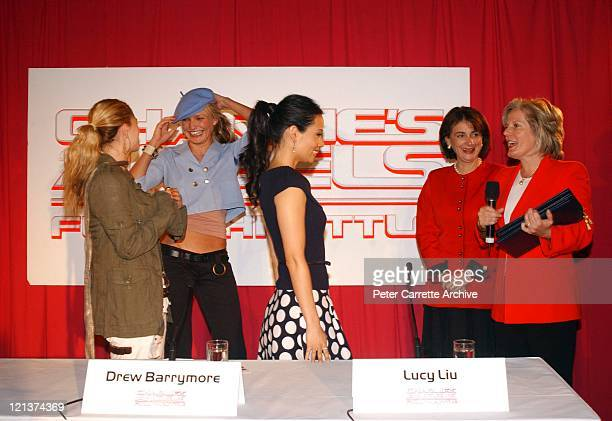 Actors Drew Barrymore Cameron Diaz and Lucy Liu are presented with Certificates of Honorary Citizenship by the Australian Minister for Arts Sandra...