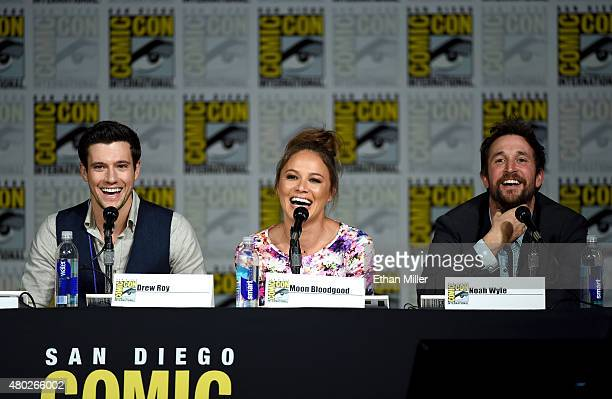 Actors Drew Roy Moon Bloodgood and Noah Wyle speak onstage at the Falling Skies The Farewell panel during ComicCon International 2015 at the San...