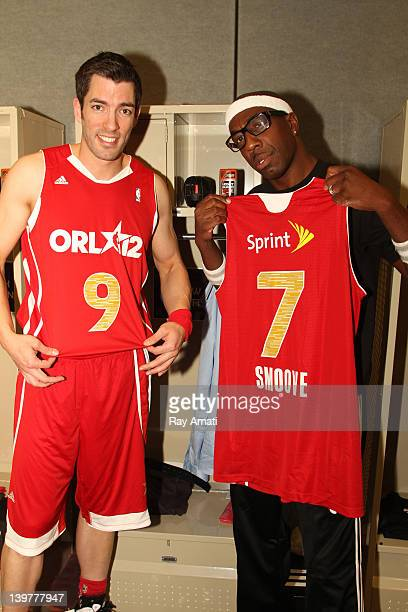 Actors Drew Scott and JB Smoove pose prior to the Sprint AllStar Celebrity Game on center court at Jam Session during the NBA AllStar Weekend on...
