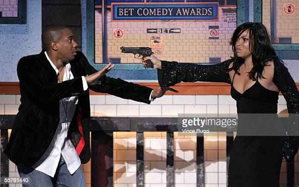 Actors Duane Martin and Tisha Campbell present an award onstage at the 2005 BET Comedy Icon Awards at the Pasadena Civic Auditorium on September 25...