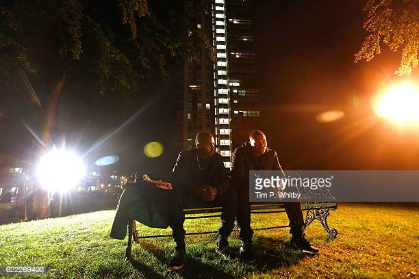 Actors Duayne Baochie and Franz Drameh on the set of 100 Streets in Wandsworth on August 25 2014 in London England