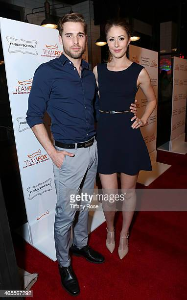 Actors Dustin Milligan and Amanda Crew attend Raising The Bar To End Parkinson's at Public School 818 on March 7 2015 in Sherman Oaks California