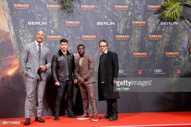 US actors Dwayne Johnson Nick Jonas Kevin Hart and director Jake Kasdan attend the German premiere of 'Jumanji Willkommen im Dschungel' at Sony...