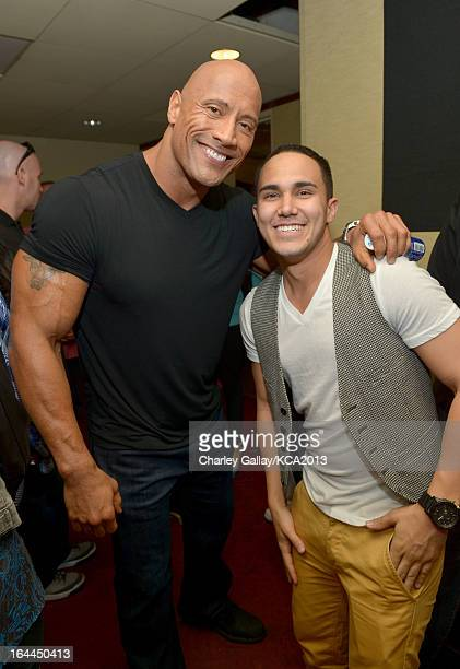Actors Dwayne 'The Rock' Johnson and actor Carlos Pena pose backstage at Nickelodeon's 26th Annual Kids' Choice Awards at USC Galen Center on March...